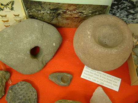 grinding stone for grain seen on right